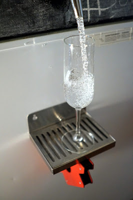 Pouring a glass of carbonated water from the tap!