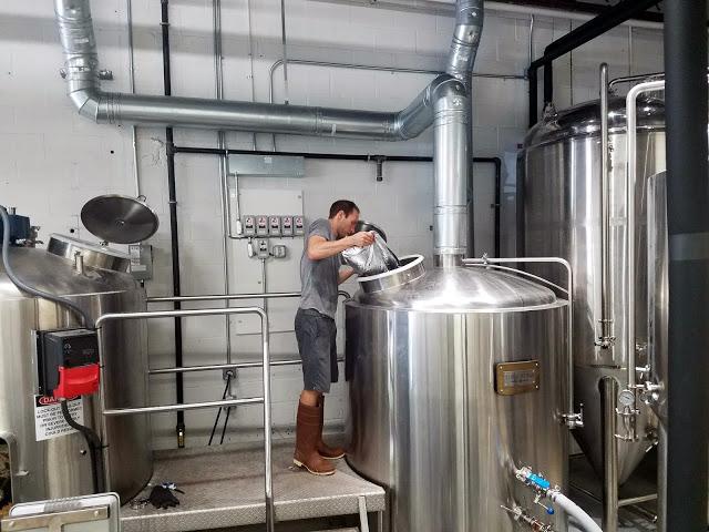 Scott adding Centennial hops to the whirlpool